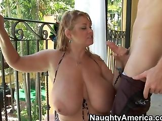 A Milf Samantha with her big melons sucks a young phallus