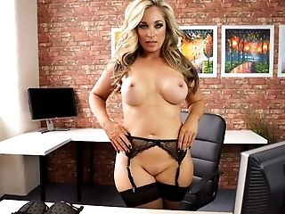 Busty office whore Kellie O'Brian would look sexy in anything she wore