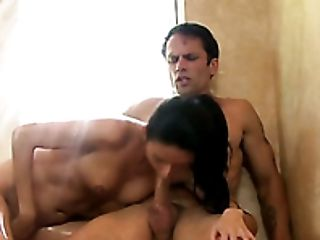 Tall black haired cutie Nikki Daniels sucks her buddy off in massage parlor