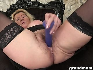 Naughty blonde MILF tries out a new dildo on her hairy pussy