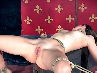 Zoey's body is tied up and her pussy attacked in the roughest way