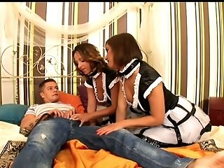 Two slutty chicks in sexy maid uniform fuck one kinky dude and polish his dick