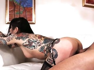 Tattooed slut Joanna Angel is impaled on hard meaty pole in flying pose