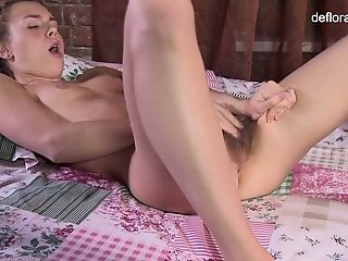 Cute pigtailed 19 yo babe Rita Mochalkina performs her untouched pussy