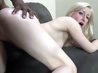 Kira Lake's shaved pussy gets pumped full of black meat on the couch