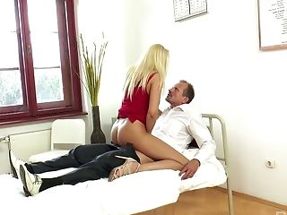 Juggy blond patient Donna Bell seduces kinky doctor and rides his hard penis