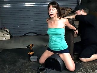 Sybian riding girl in bondage takes a hard mouth fucking
