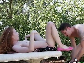 Delicious red haired curly babe Abbey Rain is making love in the garden